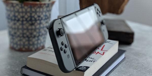 Photo by Dennis Eichler on Unsplash (Nintendo Switch on Books)